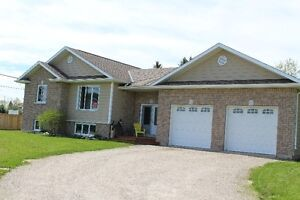 Fully detached 2 + 2 bedroom with heated attached garage
