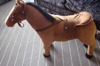KIDS RIDING HORSE WHICH MAKES SOUNDS
