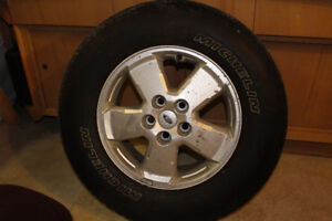 Set of Four Michelin P235/70R16 tires with alloy rims and sensor