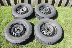 """set of 4 winter tires mounted on 14"""" Toyota steel rims"""