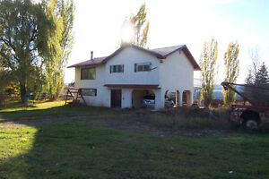 1/2 hr from town on just over an acre with view of Fraser River