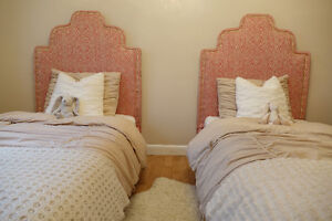 Two upholstered twin beds