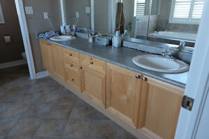 9.5ft of Maple Cabinets comes with countertop, sinks and faucets