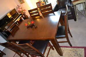 LYNFIELD DINING TABLE + 6 FAUX LEATHER CHAIRS     $350