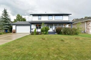 BEAUTIFUL FULLY FINISHED HOME ON LARGE MATURE LOT IN LACOMBE!