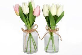 Beautiful tulips in a glass jar
