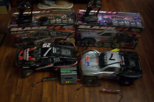 Two Traxxas Slash 4x4's for sale