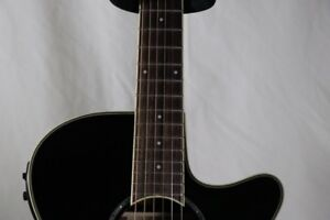 Acoustic electric hybrid-nylon-string guitar, mint condition.