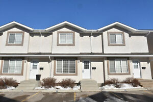 A spacious townhome w/ an unfinished basement & fenced backyard!