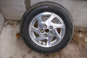 One 15 inch Tire and Rim