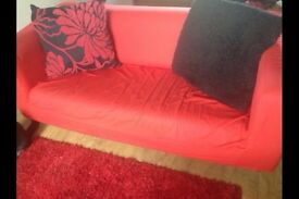 Cream sofa with red fitted cover