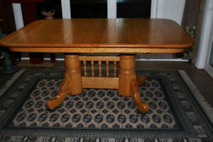 Solid Oak Pedestal table and 6 chairs for sale