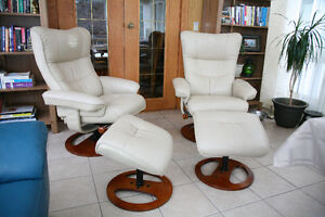 Two leather chairs and matching footrests