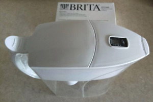 BRITA water dispenser with 4 new filters, great condition, $20
