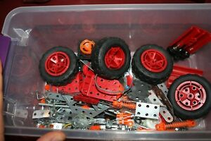 Meccano wheels, battery holder, and other pieces
