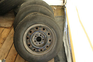4 all season tires and rims from 2001 dodge caravan(5 hole)