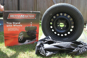 4 Tires on steel rims & vertical tire stand