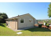 Two bedroom detached bungalow in a quiet cul-de-sac with gardens, decking and views