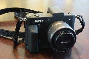 Nikon 1 V1 Digital Camera with 10-30mm zoom lens and grip
