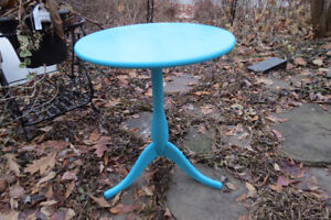 Bright turquoise round side table/plant stand