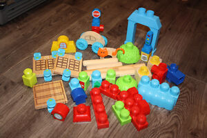 LIKE NEW MEGA BLOKS WITH WOODEN PIECES AND PLASTIC PIECES
