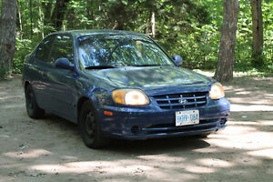 Blue 2006 Hyundai Accent coupe sold as is CERTIFIED & SAFETY
