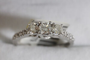 NEW WITH PROOF OF AUTHENTICITY 14K. WHITE GOLD & DIAMOND RING.