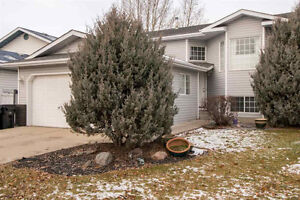 Three Bedroom Bi-Level Home With Spacious Pie Shaped Yard