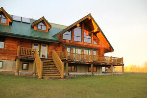 247 acres Horse Ranch with custom Log House on Swan Lake