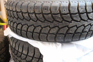 4 Mounted Winter Tires on Rims 205/65 R15 Excellent Condition!