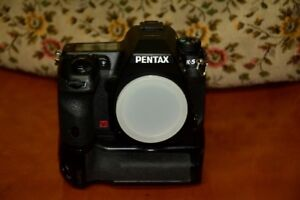 Pentax K5 with battery grip and 2 lenses