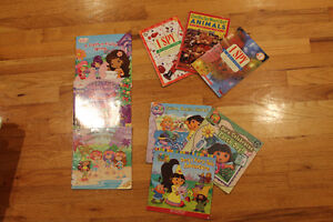 lot of softcover Dora, Strawberry Shortcake and I SPY books