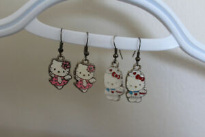 "2 PAIRS OF "" HELLO KITTY "" EARRINGS"