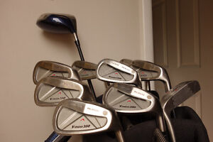 Set of Yonex irons with Nike driver, putter and bag/carrier