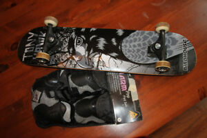 skate board and knee pads
