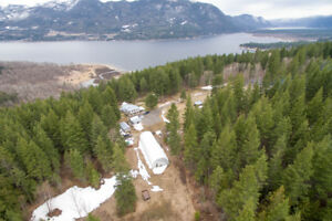 Beautiful Home on 58.2 treed acres with a view of Shuswap Lake