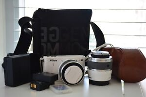 NIKON 1 J1 with 10-30 & 30-100 mm lenses + case + extra access.