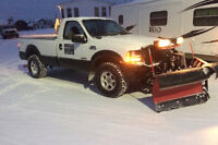 Snow clearing with  plow truck or small tractor