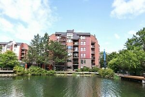 Location! Location! Fabulous condo with picturesque setting!