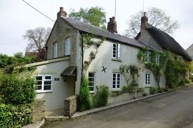 A Delightful 3 bedroom cotswold stone & brick cottage, modernised ,2 bath, utility,with small garden