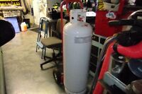 new 100lb propane bottle (filled and unused)