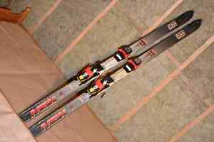 1 pair of alpine / downhill skis, poles, and bag