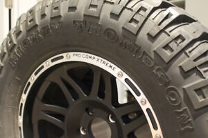 """Five 33"""" Mickey Thompson Tires with Pro Comp Series Rims"""
