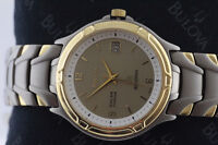 NEW BULOVA TITANIUM. 18K. GOLD MICRO PLATED SOLAR WATCH FOR SALE
