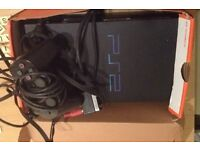PlayStation 2 with controller, dance May and game