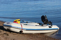 10' Zodiac with paddles and pump.