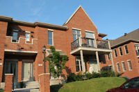Prestigious Townhouse Condo-WE PAY YOUR FIRST YEAR TAXES!!