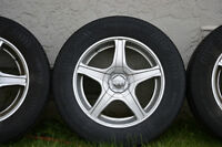 4x All season tires and 16 inch rims - 215/60R16
