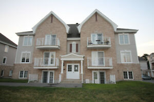 Condo, quartier Mascouche Heights, 4½, 2 stationnements, Foyer a