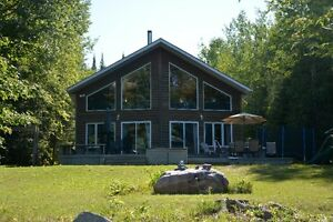 TURNKEY WATERFRONT HOME OR DREAM COTTAGE